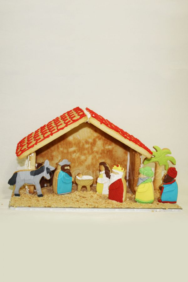 Galletas con dististas formas de tematica navideña en concreto el portal de belen decorado con fondant.
