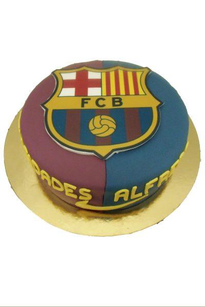 Tarta sencilla forrada de fondant de dos colores y el escudo del futbol culb barcelona en papel de azúcar.